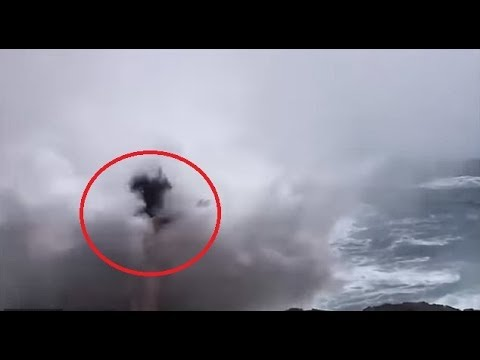 Terrifying moment a tourist posing for photos on a cliff in Bali gets swept away by a huge wave