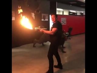 Elon musk showing joe rogan his flamethrower