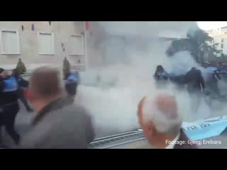 Balkan insight - albania police jump out of the way of a molotov cocktail, thrown by anti-govt demonstrators in tirana who broke