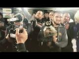 Хабиб Нурмагомедов выносит чемпионский пояс на поле стадиона Анжи Арена