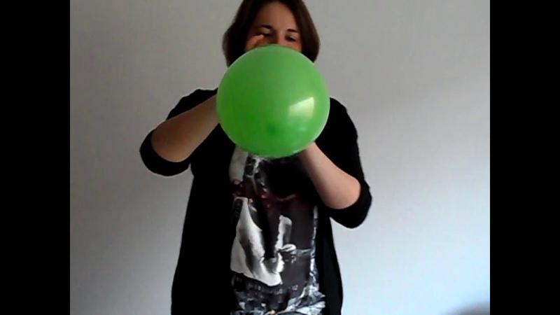 Green balloon got blown to bits by girl