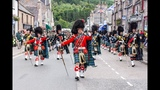 Massed Pipes &amp Drums parade through Deeside town to start the Ballater Highland Games 2018