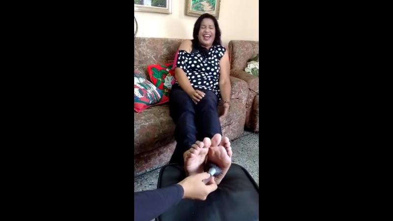Feet tickling latina