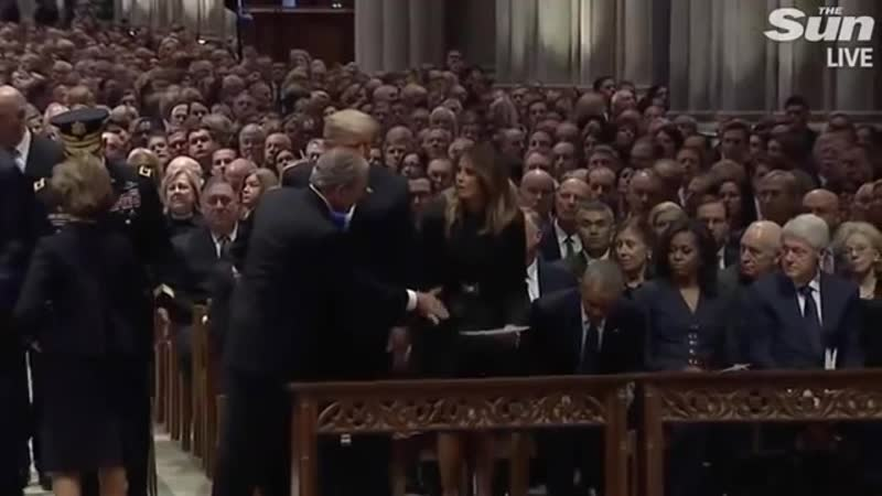 George W Bush gives Michelle Obama a mint at his dad-s funeral