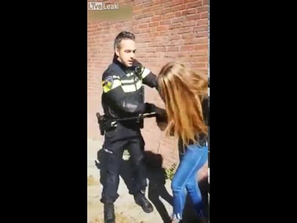 В Нидерландах полицейский производит задержание девушки