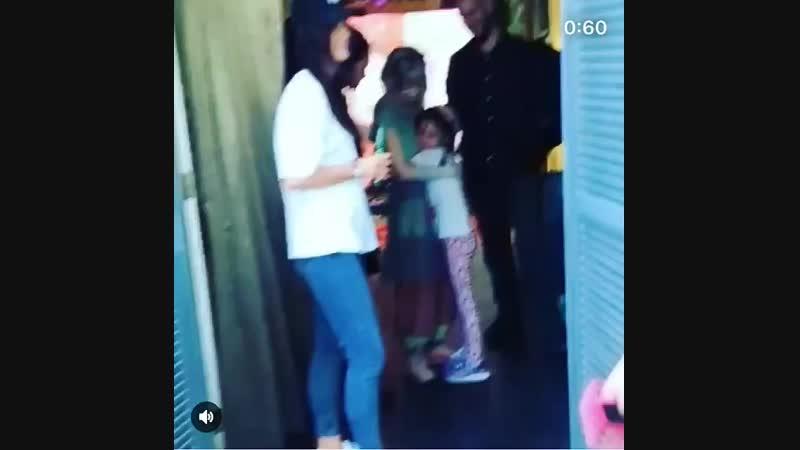 Aurora hugging a kid in Sao Paolo