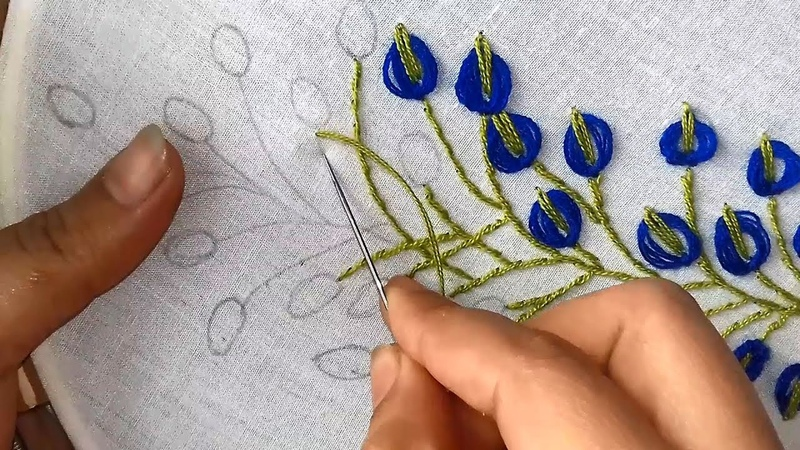 Hand Embroidery embroidery design with lazy daisy stitch.