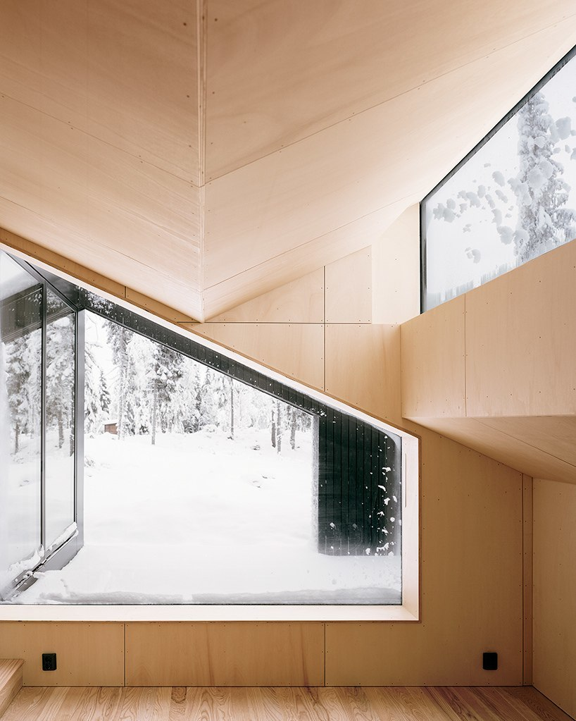 vardehaugen's cabin vindheim in norway appears to be buried beneath snow