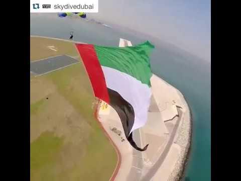 Flag of UAE in sky by skydivers