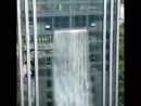 The Largest man-made waterfall outside a building in China architects architecturelovers