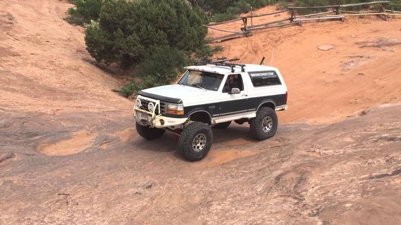 Ford Bronco drives Escalator on Hell's Revenge in Moab Utah.