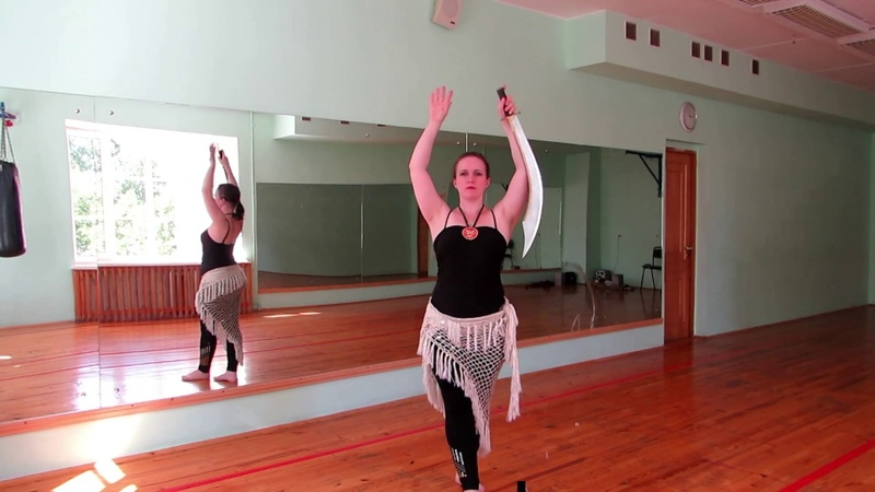 Strong arms and Sahra turn with sword 1
