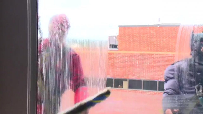 Superhero Window Washers Bring Joy At Children's Hospital