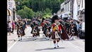 The Highlanders Pipes Drums lead the Queen's Honour Guard through Ballater to barracks Aug 2018