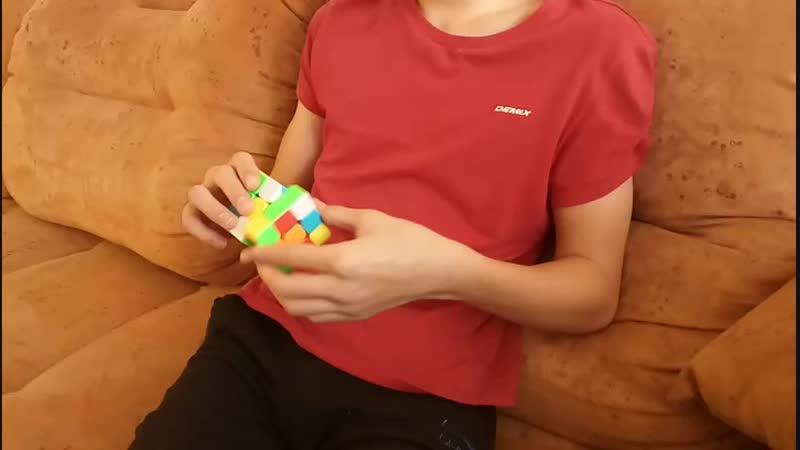 Владик. Сборка Кубика Рубика.