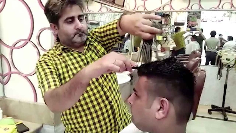 Barber's unique haircuts require 15 pairs of scissors