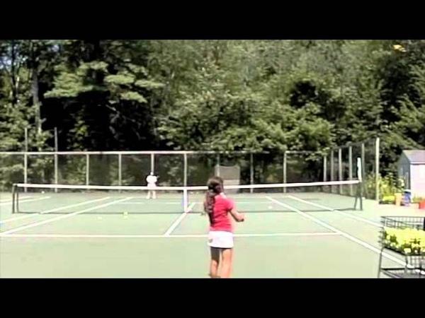 Alessia practicing her serve