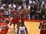 (1991)Scottie Pippen and Horace Grant grab each other in order to refrain Barkley from splitting the double team
