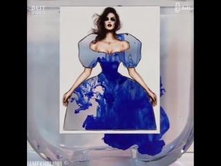 Художник использует мир для дизайна одежды