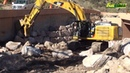 Caterpillar And John Deere Excavator In Recovery After Flooding