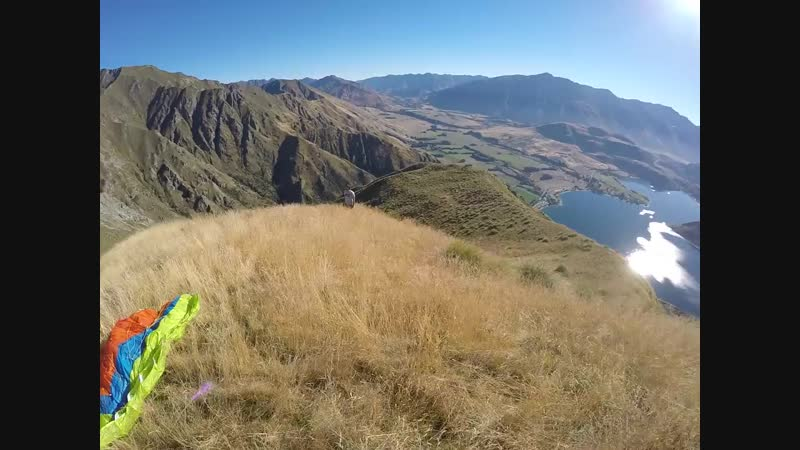 Daring Skydivers Perform Full Rotations Through New Zealand Countryside