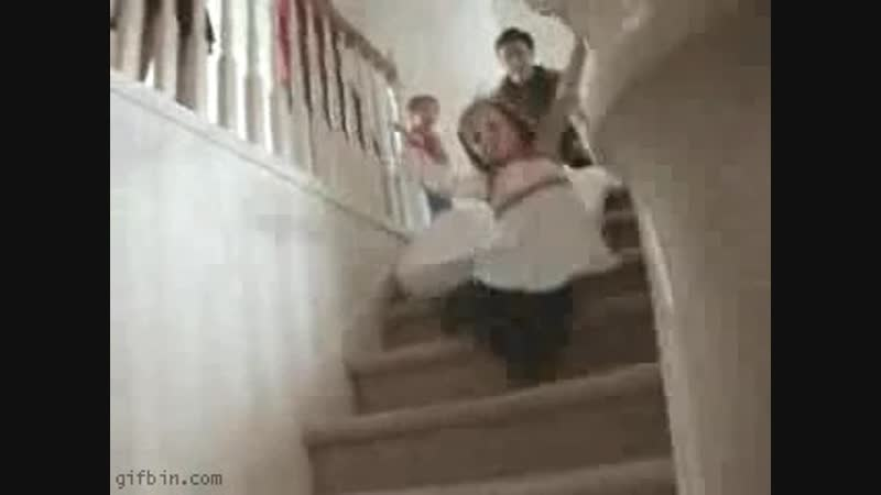 Girl falls during matress slide on the stairs