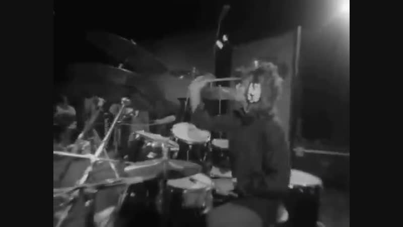 Roger playing on drums with the cig in his mouth