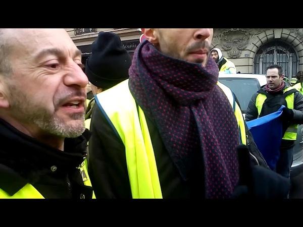 Acte X Près de Montparnasse des gilets jaunes somment des militants CGT de rentrer leurs drapeaux