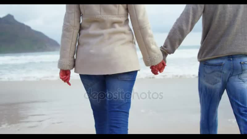 Depositphotos 135200836 stock video couple holding hands and