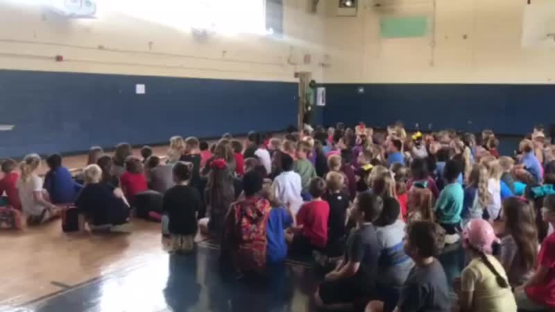 Kids in Elementary school hold a surprise party for their beloved school custodian