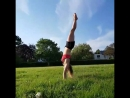 Laura Coggins Practicing rolling into a handstand