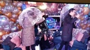 New years fail: Chrissy Teigen gets nailed in the face by Leslie Jones's umbrella