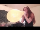 Girl Blow to pop colourful balloon 3
