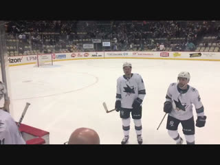 The postgame scene: chest bumps, #hockeyshoves, and one super lucky fan