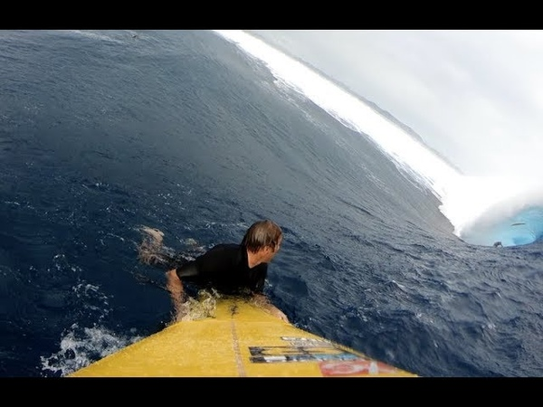 Watch Monster Cloudbreak Swell from the Paddle Perspective