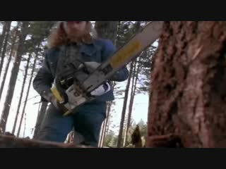 Chuck Norris stops a chainsaw bare handed