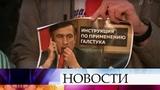 Активисты Молодой гвардии прошли перед посольством Украины в Москве под марш Прощание славянки.