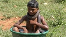 Seven-Year-Old Boy Bathes With Snakes