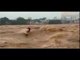 A man windsurfing in the flood and the end is sad رجل يركب الامواج فى الفيضان والنه&#15
