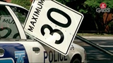Speed Sign Smashes Cop Car's Window