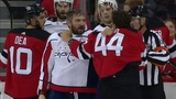 Miles Wood goes after Alex Ovechkin during scrum