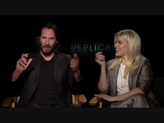 """replicas""- keanu reeves and his costar alice eve."