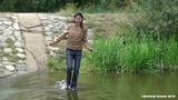 Girl swims in jacket and jeans