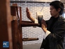 Kung Fu masters fight against wooden dummies in SE China