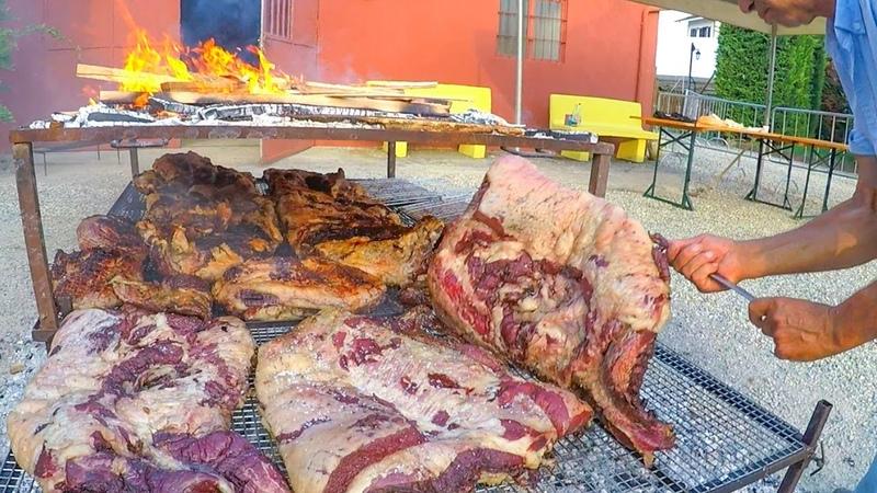 Argentinian Grill Master Roasts Huge Blocks of Bull Meat Italy Street Food Festival