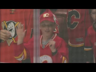 Flames Fan Tears Up After Super Nice Kid Gives His Puck To Her