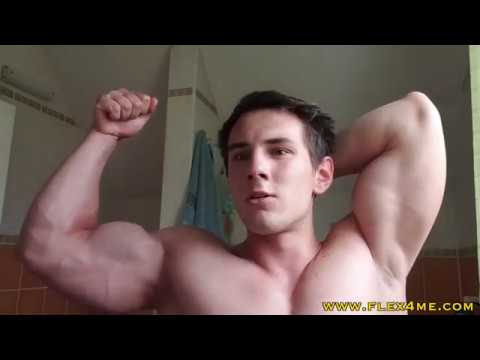 Young Muscled Hottie flexing veiny biceps
