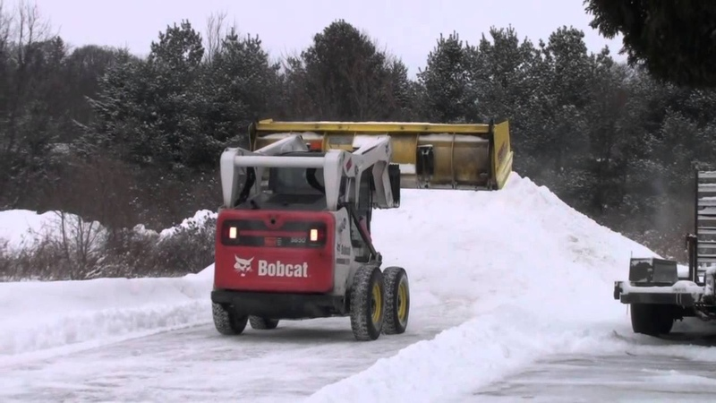 Bobcat S650 Plowing Snow With 10' Snow Wolf Ultra FastTach