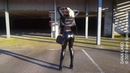 DANA LABO walking to go by car in shiny vinyl leggings and leather boots and jacket