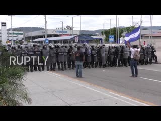 Honduras- us embassy targeted in anti-government protests ( ruptly )